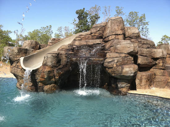 Slide grotto and waterfall rockscapes for Best pool design 2015